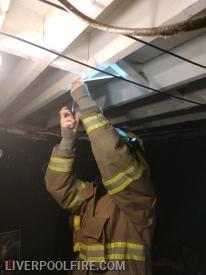 Firefighter/Bunk-in Dalton Majors installing a smoke detector